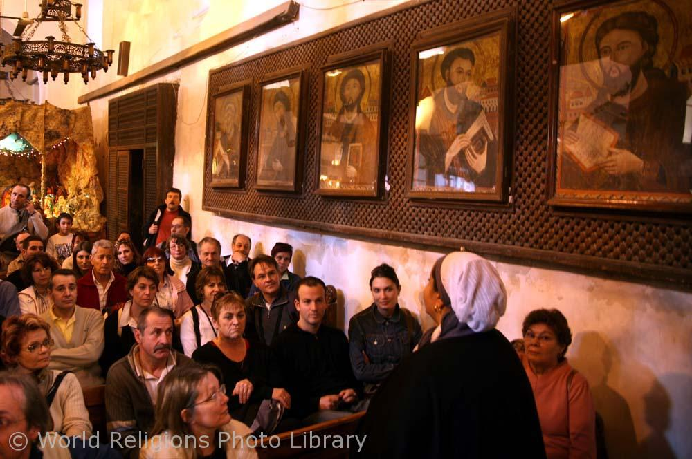 French tour group in st Barbara Coptic christian church in Cairo Egypt