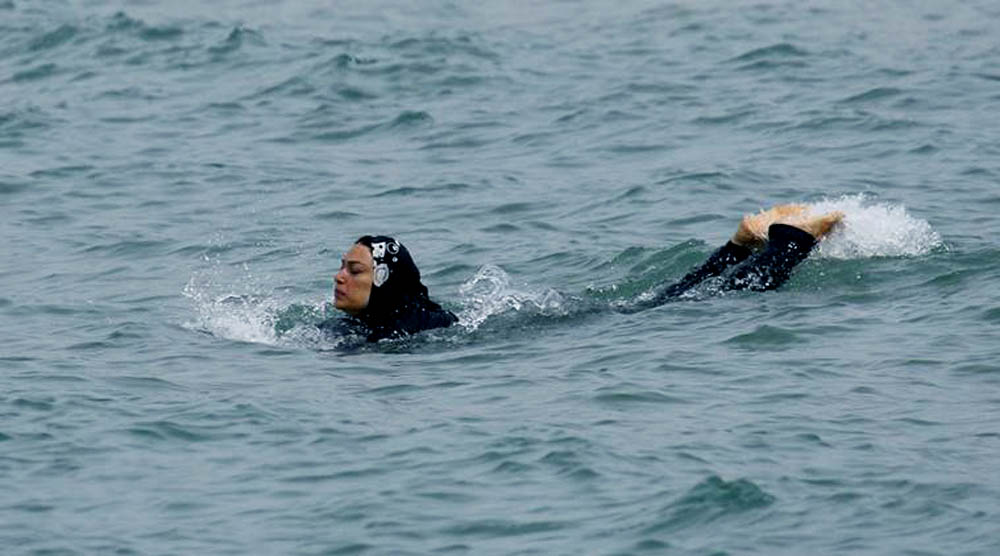 A Muslim woman wears a burkini, a swimsuit that leaves only the face, hands and feet exposed, as she swims in the Mediterranean Sea in Marseille, France, August 17, 2016. REUTERS/Stringer