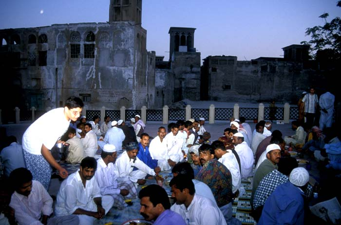 Poor Pakistan workers eating an iftar meal donated by a wealthy Arab in Dubai